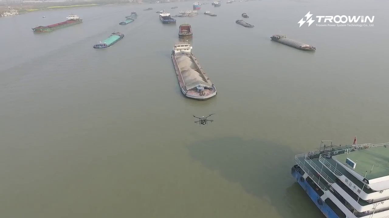 Hydrogen fuel cell powered multi-rotor drone cruising over the Yangtze River in China
