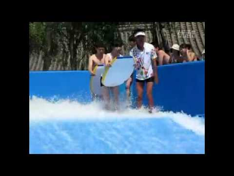 Bikini falls off on waterslide