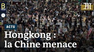 Hongkong : la Chine diffuse des images de blindés et durcit le ton