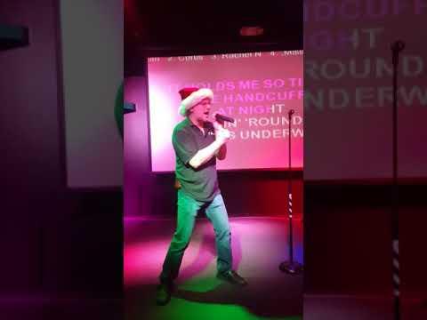 Goadie singing karaoke at Louise Christmas song walking around in women's underwear