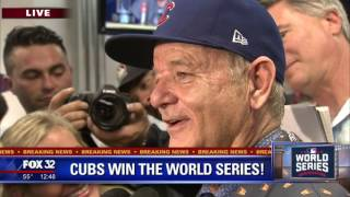 Bill Murray sprays media with champagne