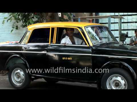 Ambitious Mumbai : rush, hard work and black & yellow Fiat taxis