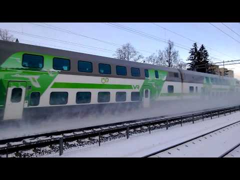 VR IC train passing by Kerava station at full speed
