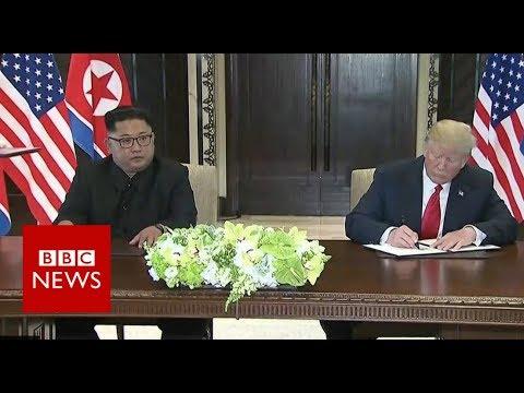 Kim Jong-Un and Donald Trump sign a