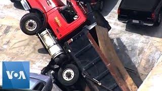 Dump Truck Collapses Through Massachusetts Parking Garage