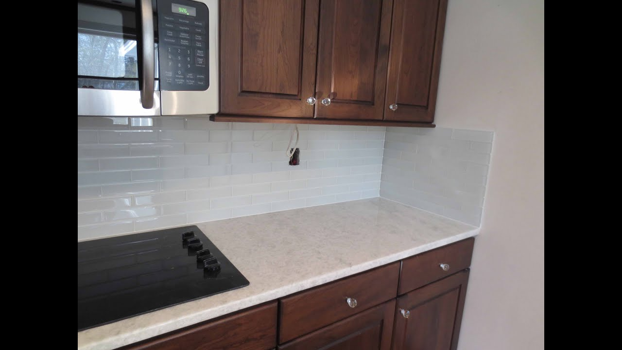 How to install glass tile kitchen backsplash youtube How to put tile on wall in the kitchen