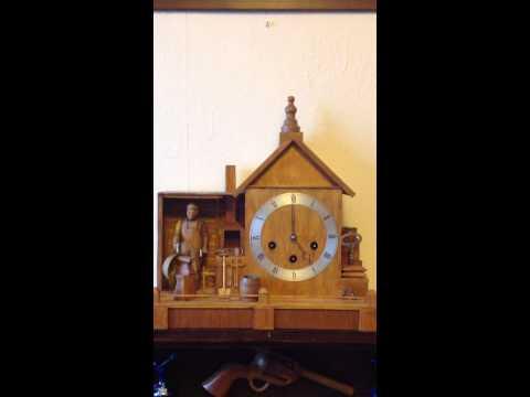 Rare carved wood automaton mantel clock