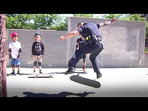 Police officer skateboards with kids