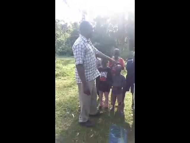 Haron Helping & Praying for Children Washing Clothes 8 19 2018