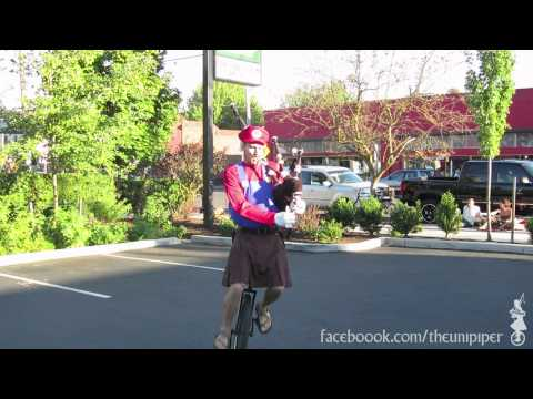 Mario Rides a Unicycle in Portland while playing Super Mario World on Bagpipes - The Unipiper