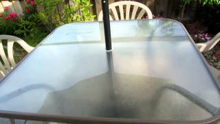 Review of Garden Treasures Glass Top Dining Table and Market Umbrella with Resin Basea