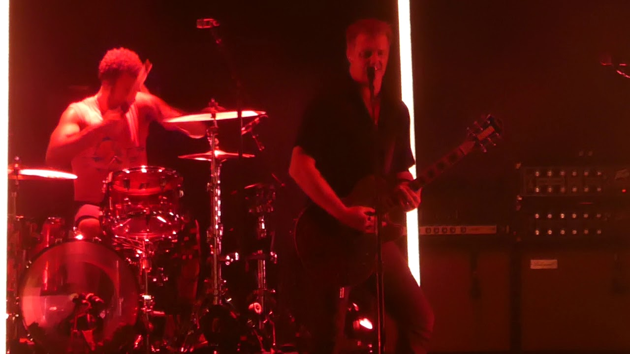 Watch QOTSA's Josh Homme break up a fight at a show