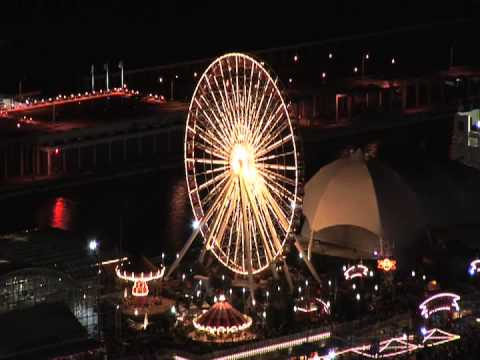 Chicago Navy Pier Ferris Wheel Lights Show from Aerial View at Night on Lake Michigan Shoreline