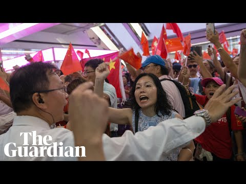 Pro-democracy protesters clash with Beijing supporters after standoff in Hong Kong mall