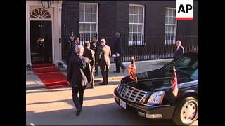 WRAP US president arrives Downing St, first ladies; ADDS Clinton, Miliband, interiors