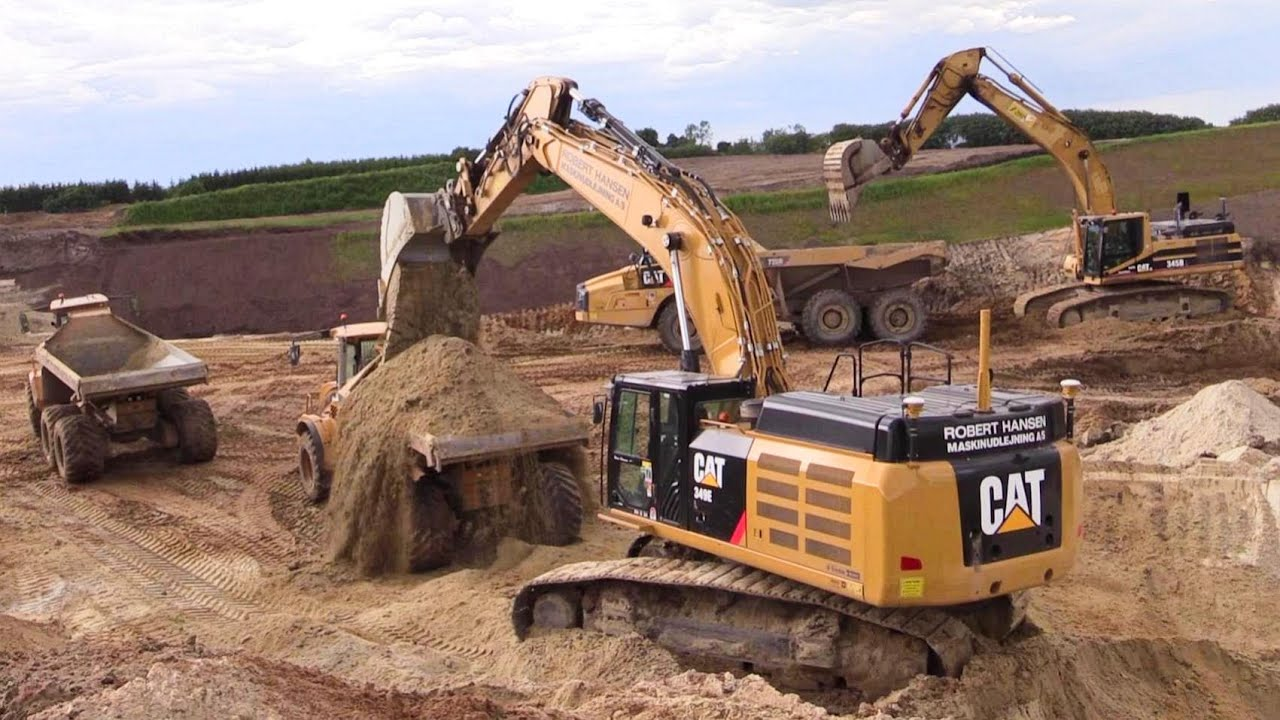 Cat 349e And Cat 345b Excavator Loading Volvo And Hydrema