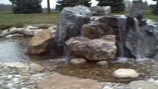 360 Degree Pondless Waterfall Going Under Land Bridge & Driveway With 100' Of Stream