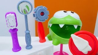 Om Nom visits dentist. Toys video for kids.