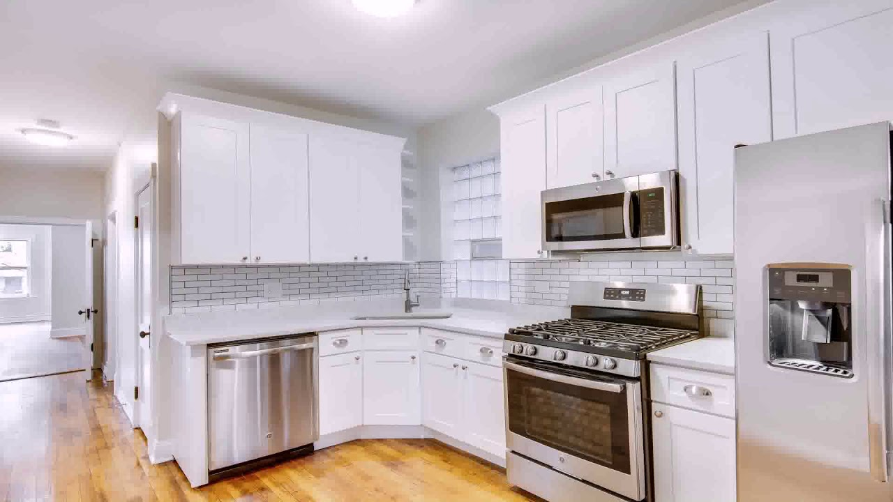 Stainless Steel Appliances In A Kitchen With White Cabinets 2022