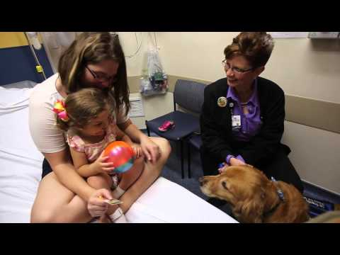 Speech therapy patient forges bond with Compass, the Memorial Pet Therapy dog.