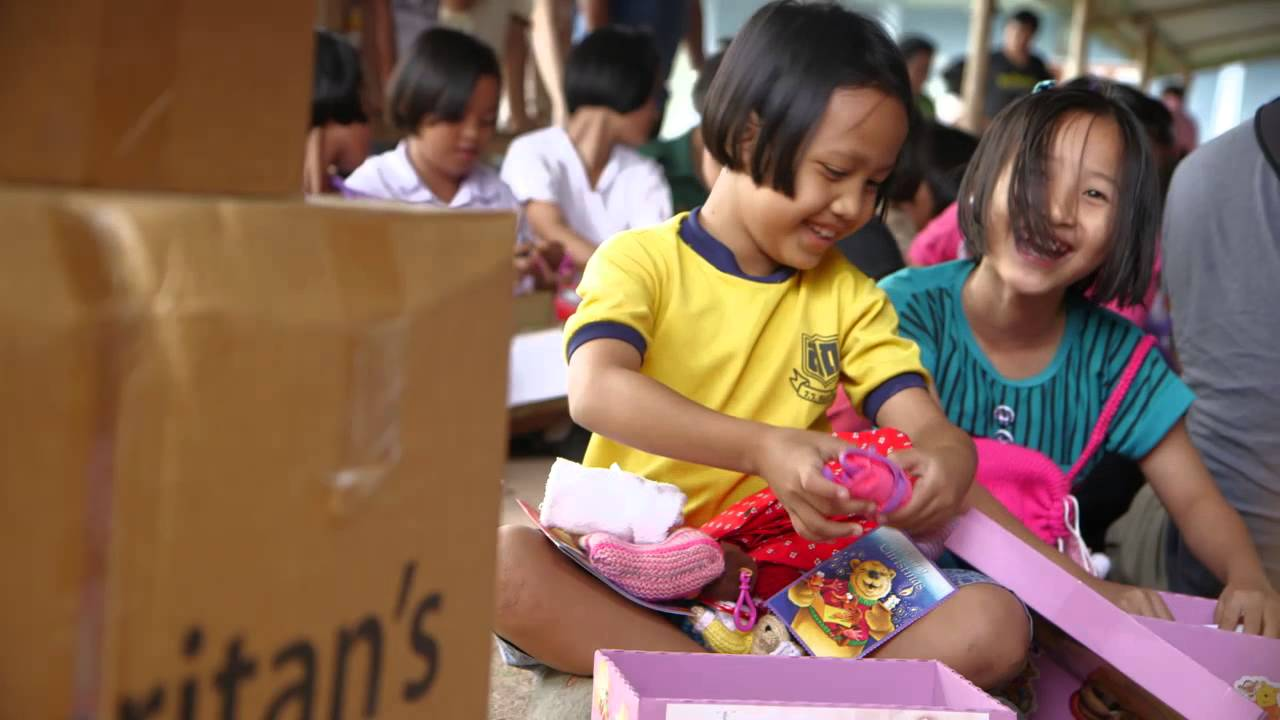 thai child Thai Girls Laugh While Opening Their Shoe Boxes - Operation Christmas Child