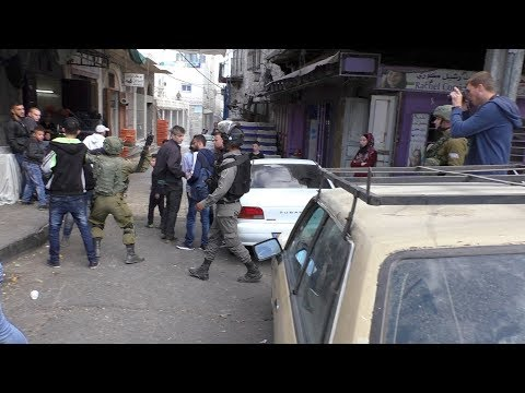 Israeli soldier beats Palestinian teen in the head with gun, during settler procession, Hebron