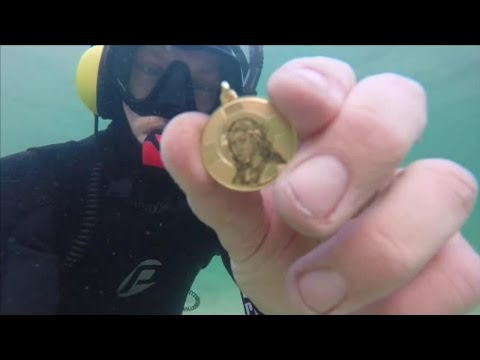 Thumbnail: TREASURE FOUND IN THE OCEAN! Guns, Gold, Silver, Cell Phone & Coins Metal Detecting Underwater!