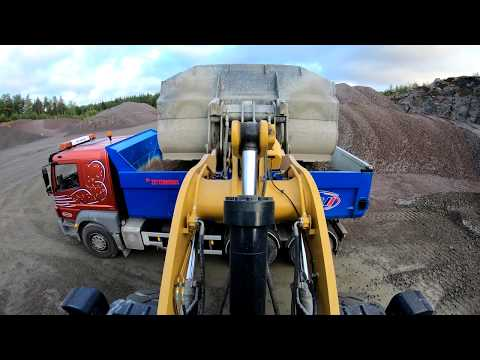 A Day At Work Caterpillar 972M XE Wheel Loaders Loads Truck And Dumpers