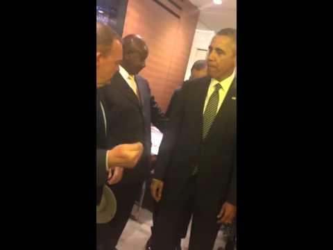 His Exellency Yoweri Kaguta greeting Obama