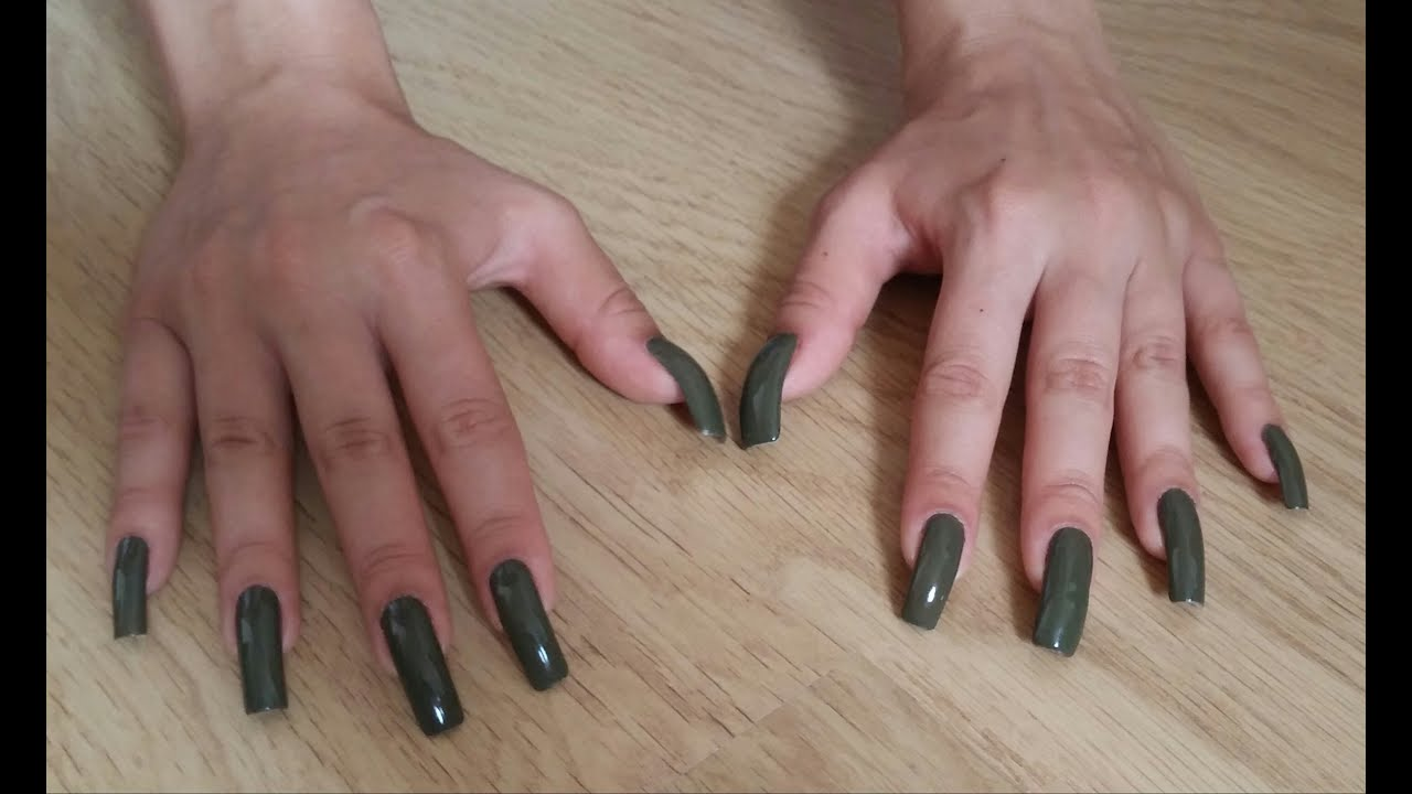 Scratching wooden parquet with natural, long, green nails - Cayenne ...