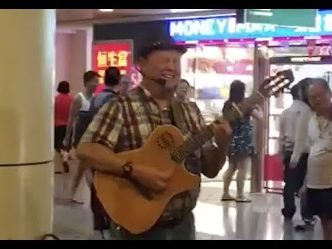 Singapore's Bob Dylan, sings about HDB and MRT