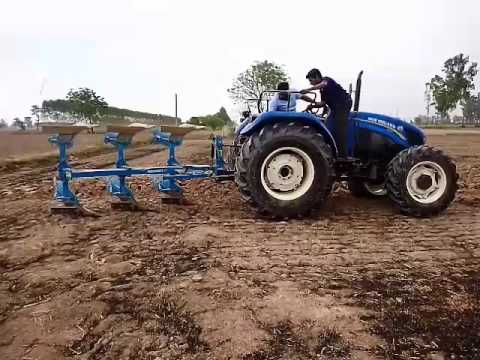 New Holland 9010 with Lemkin MB reverse ploughing