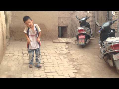 6-year old Uighur kid interprets Gangnam Style