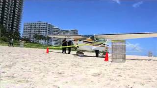 Small plane lands on sand in Miami Beach