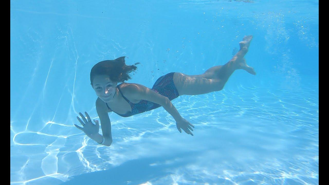 Carla Underwater swimming in a very big pool