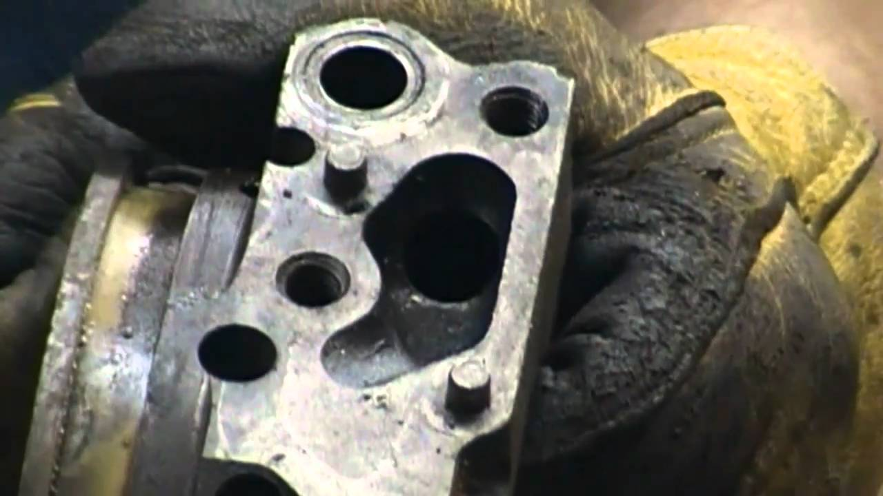 Using a die grinder on a Oldsmobile 455 engine block during a rebuild