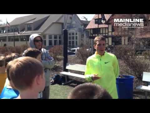 Zach Miller talks to the Rosemont School track team