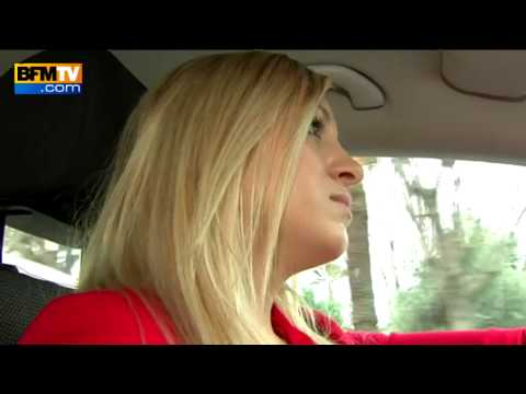 Transport de malades : portrait d'une jeune femme chauffeur de taxi