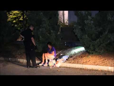 Police lock up homeless woman passed out in mulch next to town hall    9 4 15