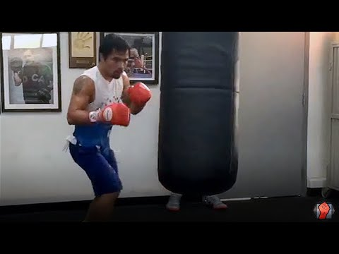 Watch Manny Pacquiao kill the heavy bag with 10 punch combos ahead of Mayweather fight