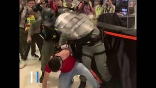 """香港周六再现小规模抗议 """"黑衣人""""上街反对""""水货客"""""""