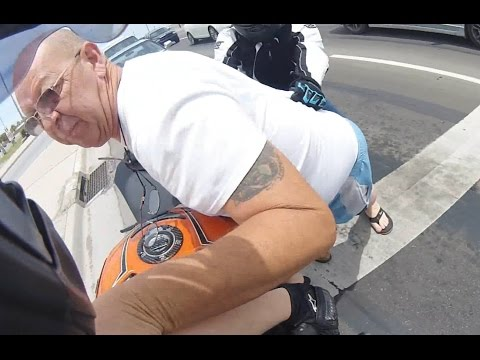 Road rage driver assaults motorcyclist, gets taken down