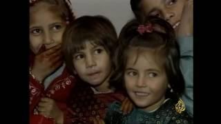 أرشيف- اتفاق كرزاي ورباني لإرساء السلام الداخلي بأفغانستان