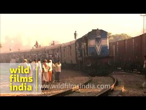 Packed Indian train with school-boy running on the roof!