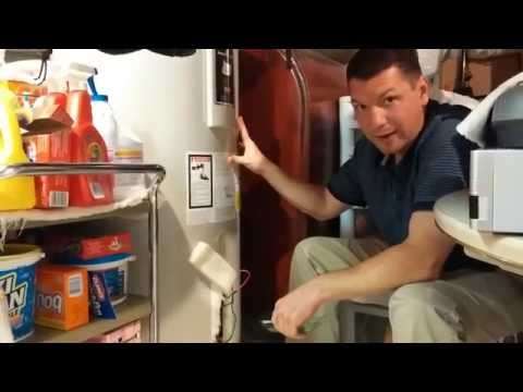 Change a hot water heater element without draining or spilling water