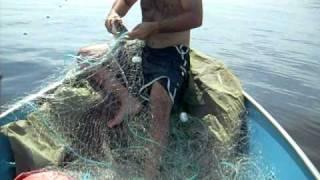 pescaria de rede na baia de guanabara