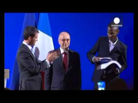 Paris hostage hero becomes a French citizen