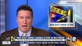 Man shot inside T-Mobile store