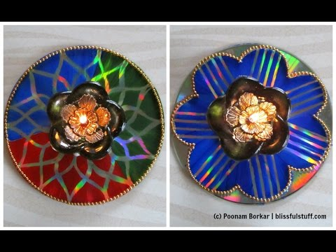 Two innovative cd candle holders recycling old cds for Waste material handicraft