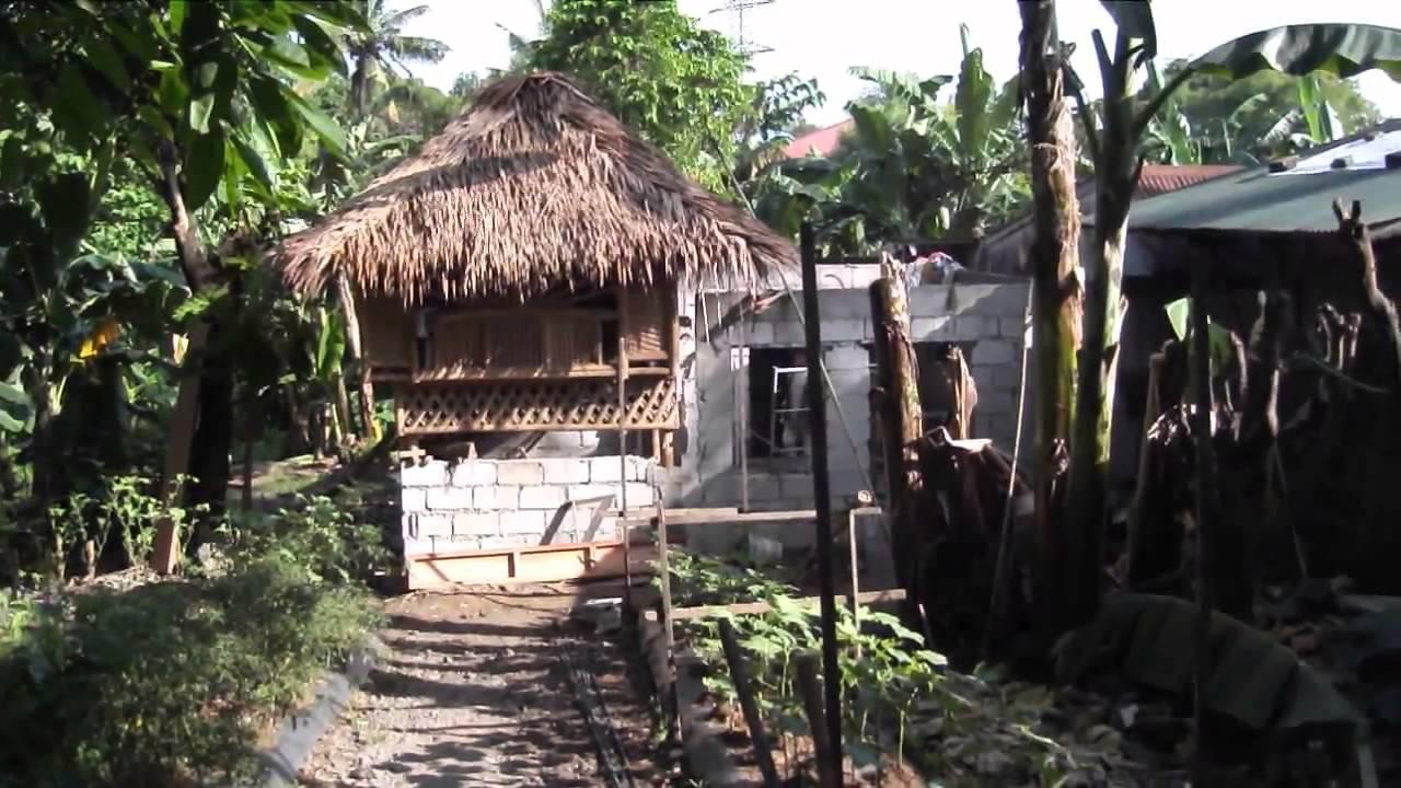 Bamboo hollow block combination filipino home under construction